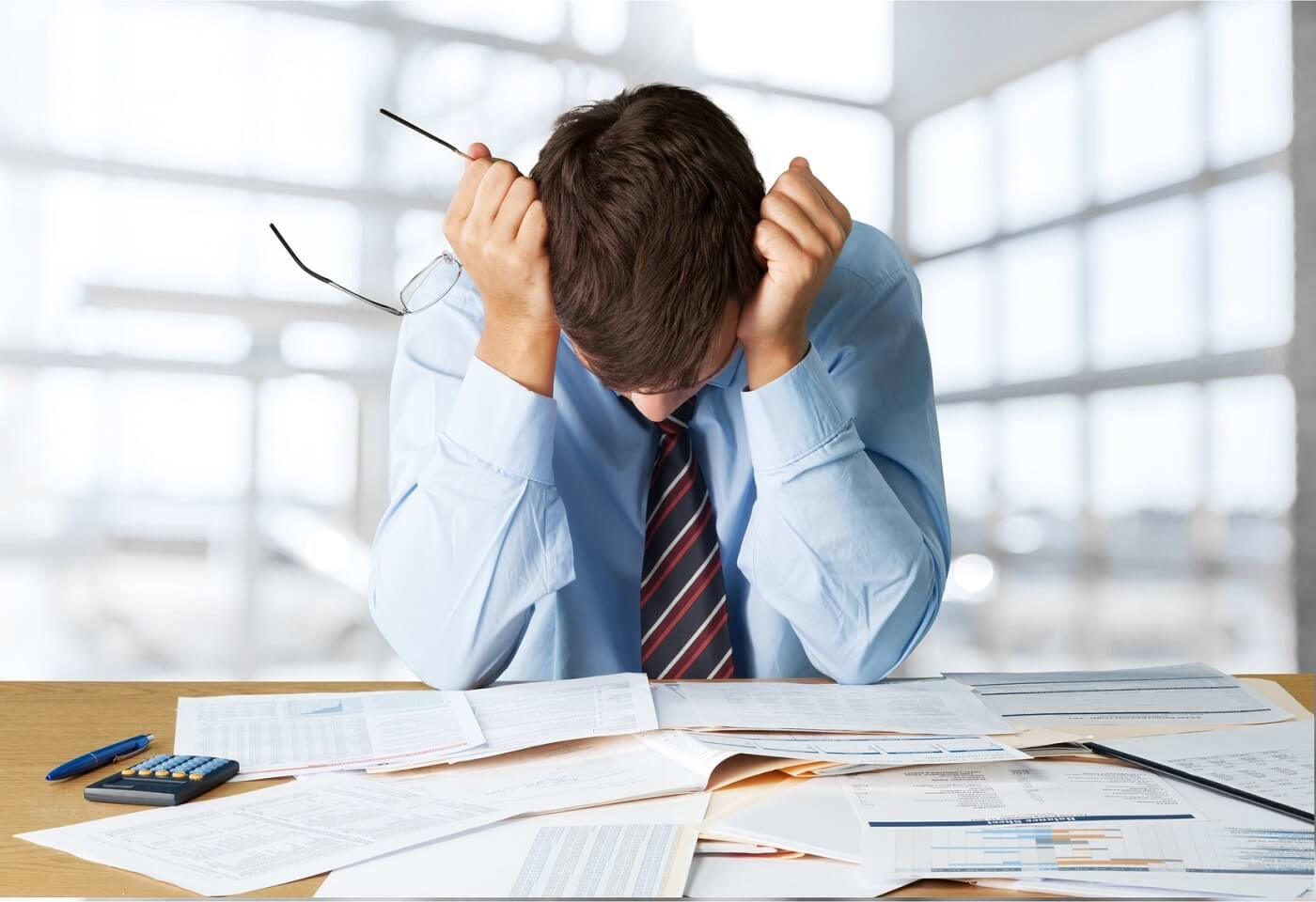 person-looking-over-finances-during-bankruptcy